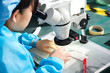 Chinese worker on factory check microscope
