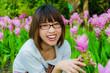 Healthy Thai girl is loving the Siam Tulip flowers