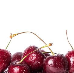 Close up of fresh cherry berries isolated on white.