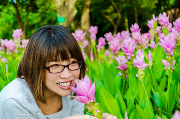 Cute Thai girl scent a pink Siam Tulip