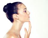 Fototapety Beauty Portrait. Beautiful Spa Woman Touching her Face