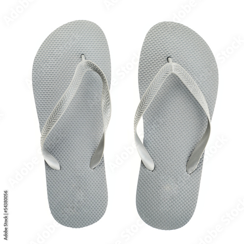 Grey rubber flip-flops isolated