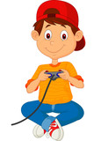 Fototapety Child plays games on the joystick
