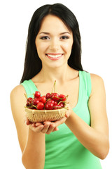 Girl with fresh cherries isolated on white