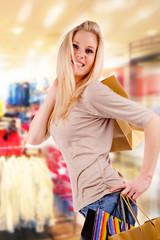 Beautiful blond girl in shopping mall