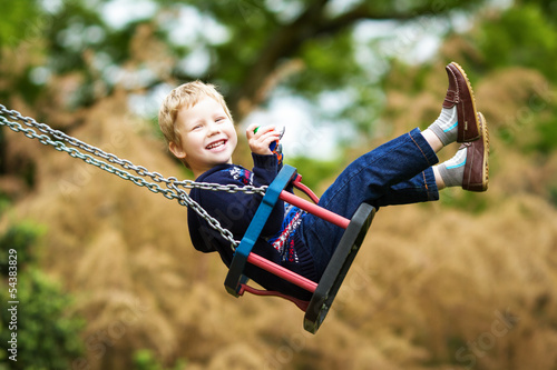 canvas print picture Little child on swing
