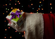 Santa Claus hand holding gift box on bright background