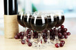 Red wine in glass on room background
