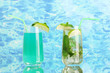 Two cocktails on blue background