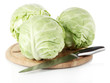 Cabbage on board for cutting isolated on white