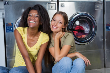 Female Friends Sitting Together At Laundry