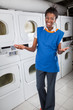 Happy Female Helper Gesturing In Laundry