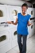 Happy Female Helper Gesturing In Laundry