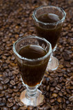 coffee liqueur into a shot glass, selective focus