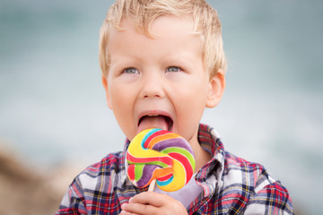 Little boy with lollipop