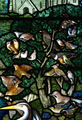 Stained glass birds in a tree