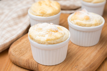 peach souffle in the portioned form on a wooden board