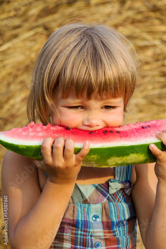 The portrait of the girl eats water-melon