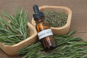 Rosemary herb and aromatherapy  essential oil dropper bottle