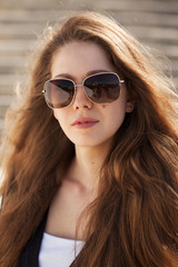Beautiful young woman in stylish sunglasses
