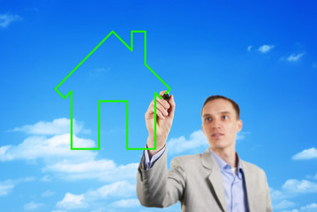 Man drawing a house in the sky