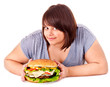 Woman holding big hamburger.