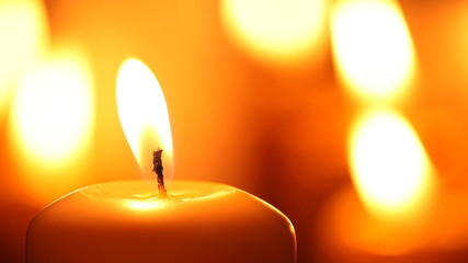 Close-up of candle and match.