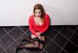 Female prostitute sitting on the floor