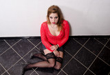 Female prostitute sitting on the floor