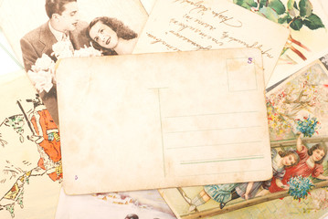 Group of vintage postcards, with empty one in the centre