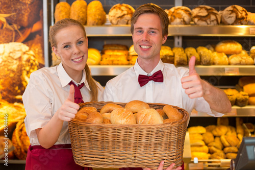 Bakers in bakery with basket full of bread