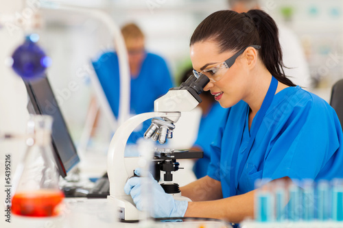 young scientist using microscope