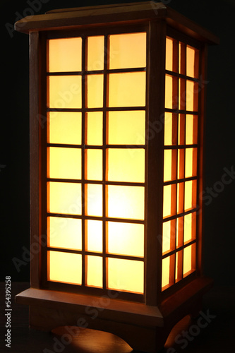 Japanese table lamp on black background