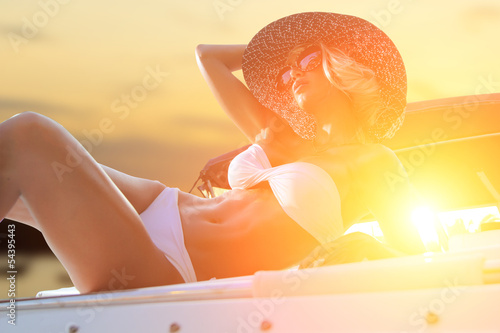 Hot fit woman on her yacht