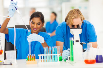 scientists in chemical laboratory