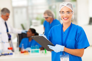 female medical researcher writing report