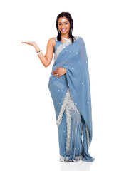 indian woman wearing sari presenting