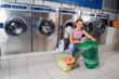 Woman With Baskets Of Clothes At Laundry