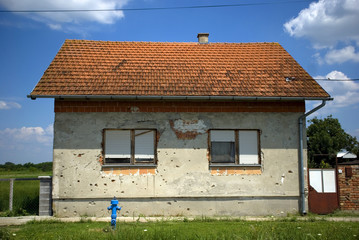 House with bullet tracks, Laslovo, Croatia