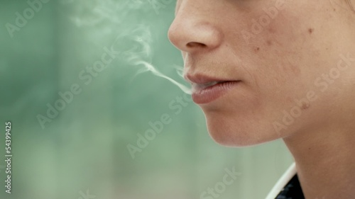 Business woman smoking electronic cigarette. 5 of 6