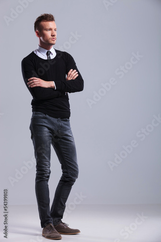 casual man stands with hands folded