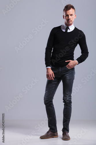 casual man standing with hand in pocket