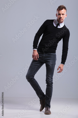 casual man leaning on a side