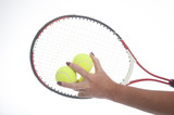 Female tennis player holding racquet and balls