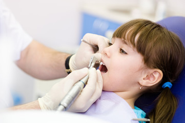 close-up medical dentist procedure of teeth polishing