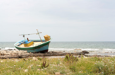 Abandoned boat on the beach