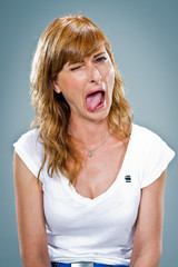 Young Happy Woman Sticking Out Her Tongue