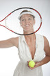 Female tennis player holding racquet