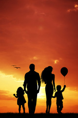 Happy family at sunset