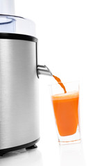 Fresh carrot juice with juicer isolated.